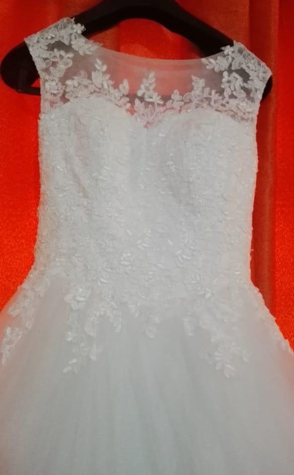 High neck lace wedding dress close view