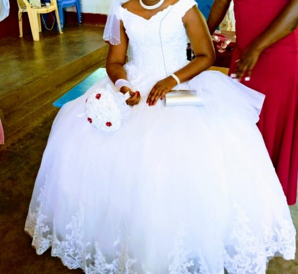 Off the shoulder lace ball gown bride view