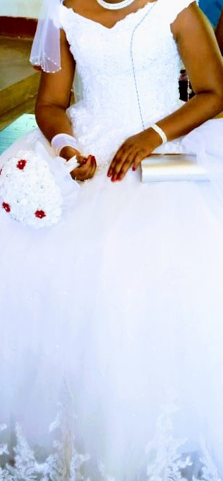 Off the shoulder lace ball gown close view
